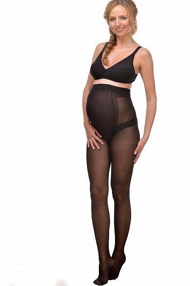 беременная в черных чулках со швом фото